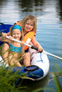 Two young girls at a lake Stock Photography