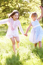 Two Young Girls Playing In Field Stock Image