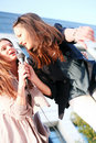 Two Young Girls Singing Karaoke
