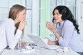 Two young girls working Royalty Free Stock Photo