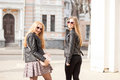 Two young girsl hanging out in the city Royalty Free Stock Photo