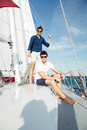 Two young handsome happy men standing on the yacht Royalty Free Stock Photo