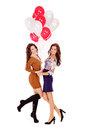 Two young happy woman with a gift beautiful women happily holding Stock Images
