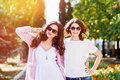 Two young happy women walking in the summer city Royalty Free Stock Photo