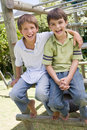 Two young male friends at a playground smiling Stock Image