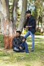 Two young men in casual trendy clothes in a park Royalty Free Stock Photo