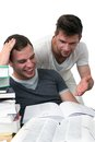 Two young men studying together Stock Image