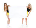 Two young pretty women empty board text white background Stock Photography