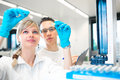 Two young researchers carrying out experiments in a lab Royalty Free Stock Photo