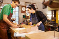 Two young shoemakers preparing shoe lasts in a workshop Royalty Free Stock Photo