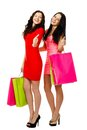 Two young shopping women showing thumb up smiling standing and Stock Photo