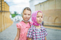 Two young sisters who wear headscarf in historic part of city Royalty Free Stock Photography