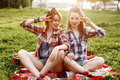 Two Young Smiling Hipster Girls Having Fun