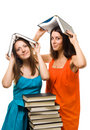 Two young student woman play with books Royalty Free Stock Photo