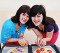 Two young woman cooking Royalty Free Stock Image
