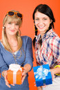 Two young woman friends hold party presents Stock Photography