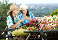 Two young woman gardening Royalty Free Stock Image