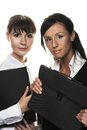 Two young woman menagers pretty women with folders Stock Photo