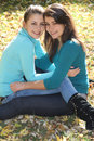 Two young women on autumn background Royalty Free Stock Photo