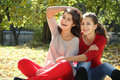Two young women on autumn background Stock Images