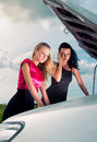 Two young women with broken car Royalty Free Stock Images