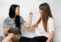 Two young women chatting Royalty Free Stock Image