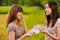 Two young women concluding bargain Royalty Free Stock Photo