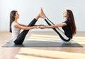 Two Young Women Doing Yoga Asa...