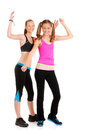 Two young women doing zumba fitness Stock Photos