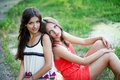 Two young women in dresses Royalty Free Stock Photo