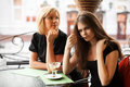 Two young women eating an ice cream Royalty Free Stock Photo