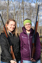 Two young women with guns at trap shooting range Royalty Free Stock Photo