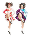 Two young women in irish dance dress dancing isolated and wig Stock Photos