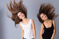 Two young women jumping Royalty Free Stock Photo
