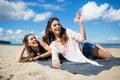 Two young women lying on beach having fun Royalty Free Stock Photo