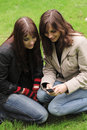 Two young women with a mobile phone Royalty Free Stock Photo