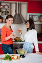Two young women in modern kitchen Royalty Free Stock Images