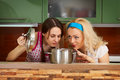 Two young women with a pot of soup Royalty Free Stock Photography