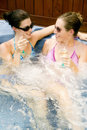 Two young women relaxing in a Jacuzzi Stock Image