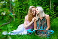 Two young women relaxing in the park Stock Image