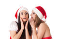 Two young women in santa costume on a white background female secrets Stock Photos