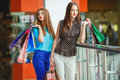 Two young women shop in a big supermarket Imagens de Stock Royalty Free