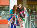 Two young women shop in a big supermarket Fotografia de Stock
