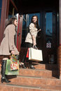 Two Young Women with Shopping Bags Royalty Free Stock Photography