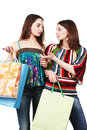 Two young women with shopping bags Stock Photos
