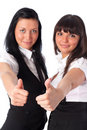 Two young women showing success handsign Royalty Free Stock Images