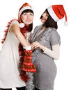Two young women taking out their Christmas present Stock Photos