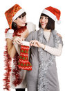 Two young women taking out their Christmas present Royalty Free Stock Photos