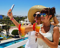 Two young women taking picture of themselves on vacation selfie Stock Image