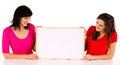 Two young women with whiteboard white background Stock Photo